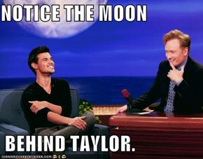 NOTICE THE MOON   BEHIND TAYLOR.