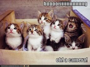 booooriiiiiinnnnng  oh! a camera!