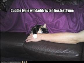 Cuddle tyme wif daddy is teh bestest tyme