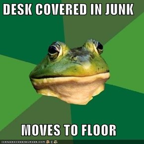 DESK COVERED IN JUNK  MOVES TO FLOOR