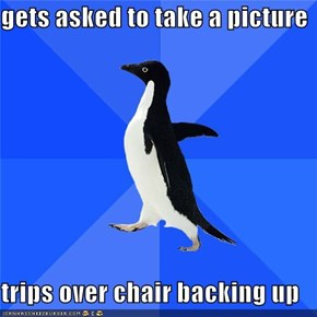 gets asked to take a picture  trips over chair backing up
