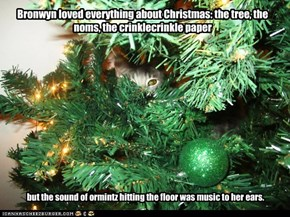 Bronwyn loved everything about Christmas: the tree, the noms, the crinklecrinkle paper