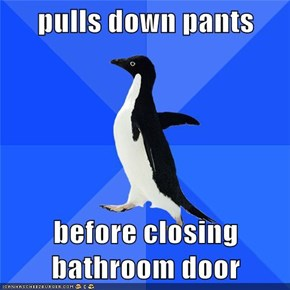 pulls down pants  before closing bathroom door