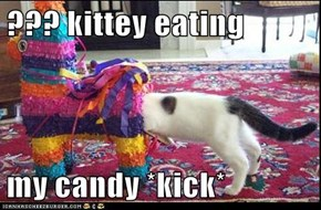 ??? kittey eating  my candy *kick*