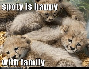 spoty is happy  with family