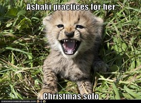 Ashaki practices for her  Christmas solo