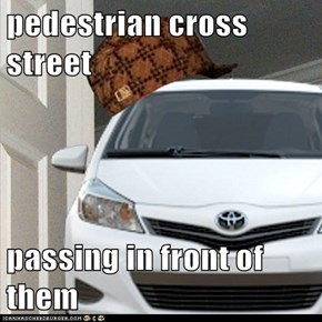 pedestrian cross street  passing in front of them