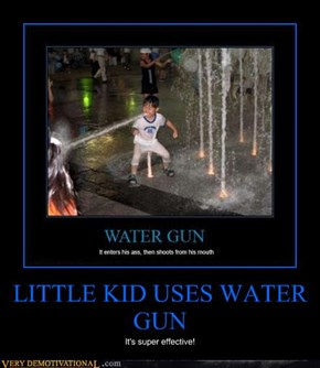 LITTLE KID USES WATER GUN