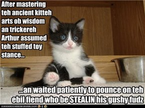 After mastering teh ancient kitteh arts ob wisdom an trickereh Arthur assumed teh stuffed toy stance...