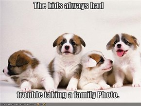 The kids always had  trouble taking a family Photo.