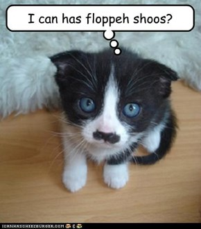 Chaplin Kitteh is finkin' cus hims in da silent moobies.