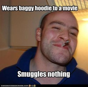 Wears baggy hoodie to a movie