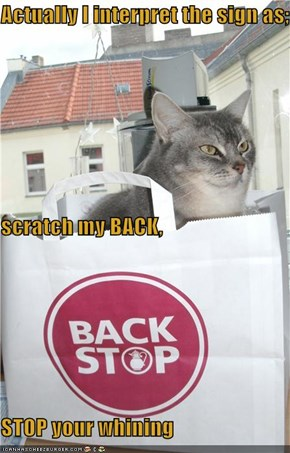 Actually I interpret the sign as; scratch my BACK, STOP your whining