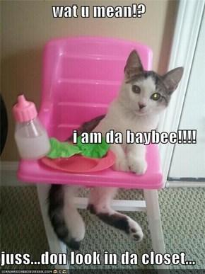 wat u mean!? i am da baybee!!!! juss...don look in da closet...