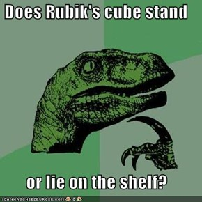 Does Rubik's cube stand  or lie on the shelf?