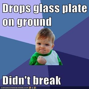 Drops glass plate on ground   Didn't break