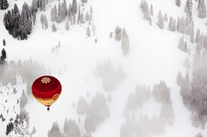 Hot Air Balloon Over Snowy Switzerland