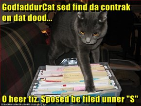 "GodfaddurCat sed find da contrak on dat dood...  O heer tiz. Sposed be filed unner ""S"""