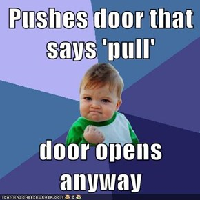Pushes door that says 'pull'  door opens anyway