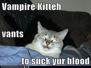 Vampire Kitteh vants to suck yur blood