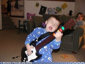 Someone Give This Kid a Real Guitar